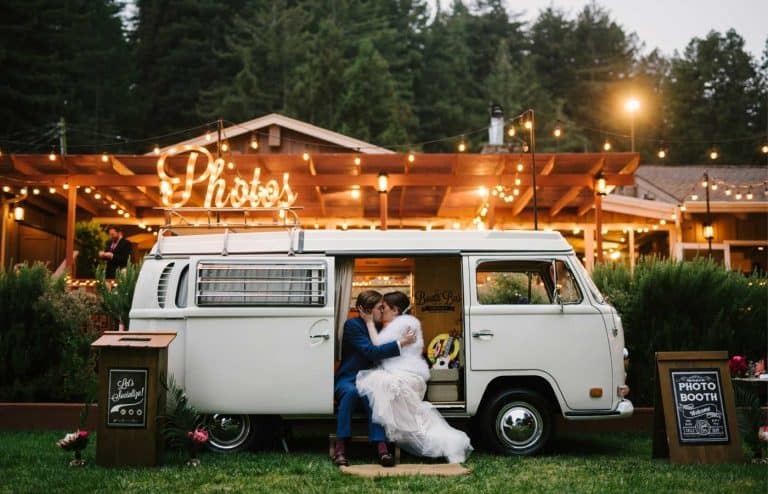Bride and Groom kissing in VW microbus photo booth