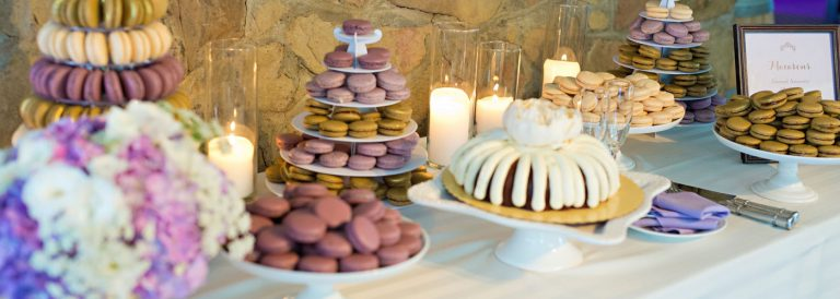 Desserts table with cakes macaroons cookies
