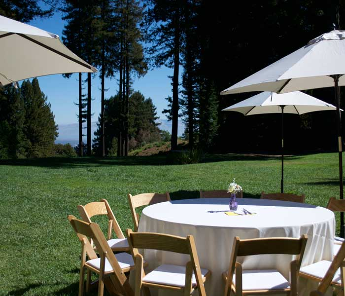 Empty round table with white linen on lot of The Mountain Terrace