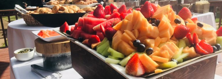 Fruit and breakfast buffet foods on deck
