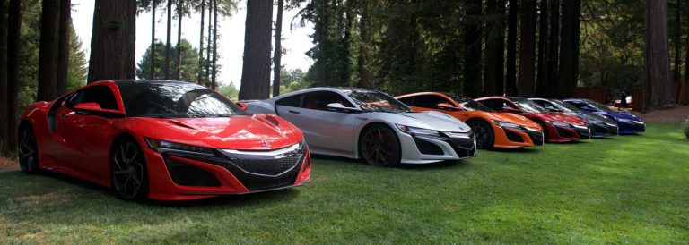 Sports car club lines up cars on lawn